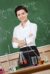 smiley_chemistry_teacher_with_crossed_arms_at_the_classroom-tall