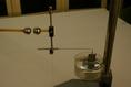 Elektromos töltés mérése hidraulikus csillapítással