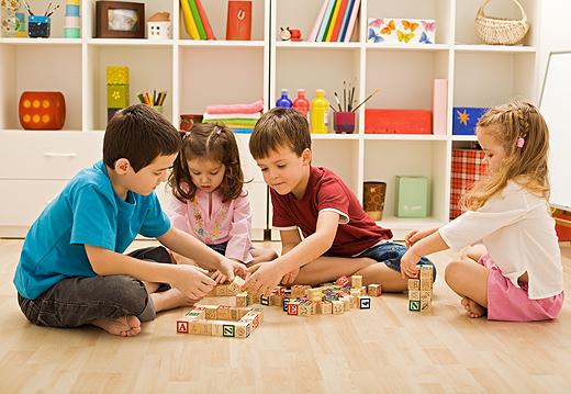 children_playing_with_blocks_on_the_floor-wide
