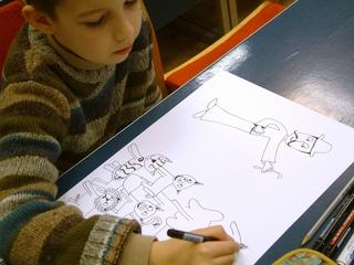 Munka közben - rajzoló fiú