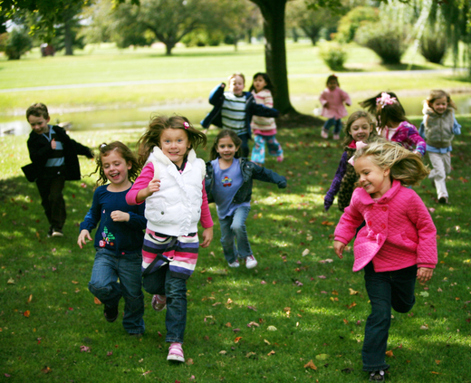 group_of_diverse_kids_running_outside_in_fall_conv