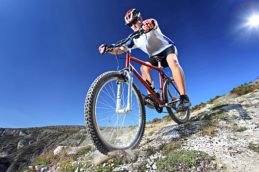 person_riding_a_bike_downhill_style-wide
