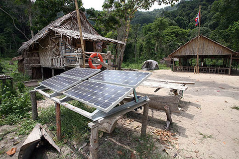 Solar-cell-panels-in-urban-village-surin-island-thailand-horizontal