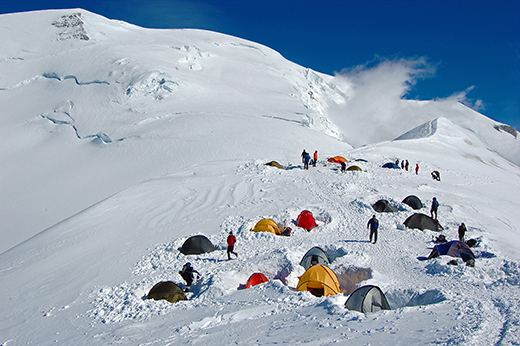 Colorful-tents-in-high-snowy-mountains-Refuge-du-Goater-horizontal