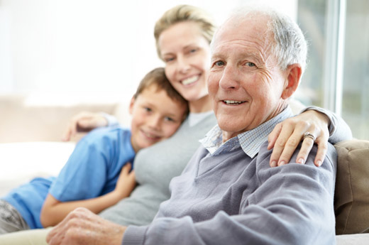 closeup_portrait_of_a_senior_man_sitting_with_his_daughter_and_grandson-wide