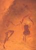Táncoló férfi és nő egy észak-afrikai sziklafestményen